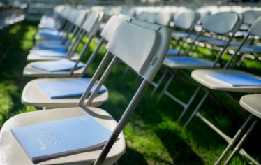rows of folding chairs at Tufts commencement
