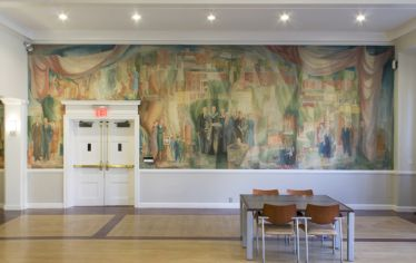 An old, large mural depicting Tufts University with students and faculty and administrators as imagined in the 1950s. The mural will be taken down and preserved for future study.