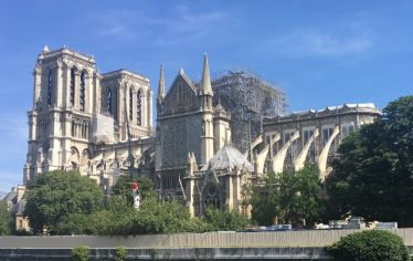 Notre-Dame Cathedral, with scaffolding for repairs to the roof. Art and architecture historian Christina Maranci talks about the restoration of Notre-Dame and other beloved cathedrals in need of attention.