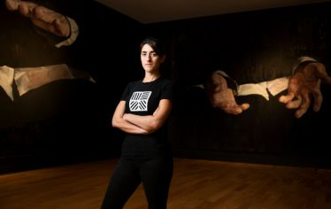Woman standing in front of art work. Boston-based visual artist Daniela Rivera won the prestigious Rappaport Prize from the DeCordova Sculpture Park and Museum.