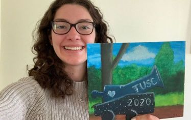 The Tufts University Social Collective mailed art supplies to interested seniors like Siobhan Shamlian, A20, who painted personalized cannons on canvas. Photo: Courtesy of Siobhan Shamlian