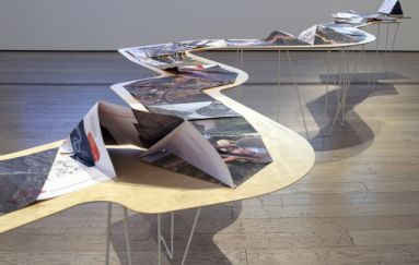 An art installation, of page sof a book spread serpentine-like along a winding table. What is an artist-book, and how far can it push convention? An exhibition at Tufts proves form is limited only by the imagination